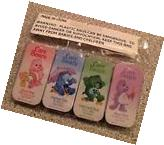 4 VINTAGE CARE BEARS LIP GLOSS TIN NEW SEALED GRUMPY GOOD
