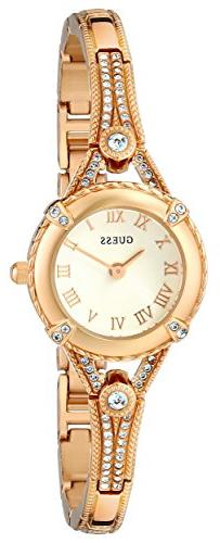 GUESS Women's U0135L2 Petite Gold-Tone Watch with White Dial